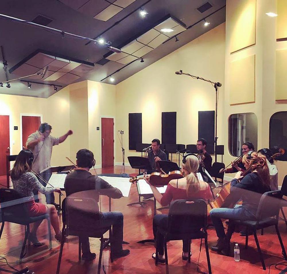 Paul conducting strings